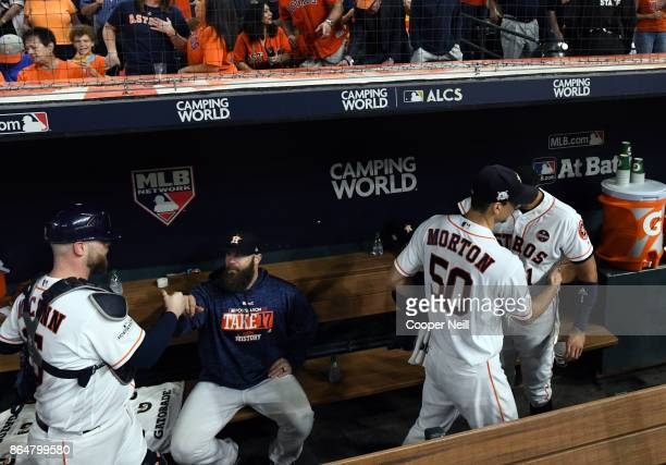 Brian McCann Evan Gattis Charlie Morton and Carlos Correa of the Houston Astros are seen in the dugout before Game 7 of the American League...