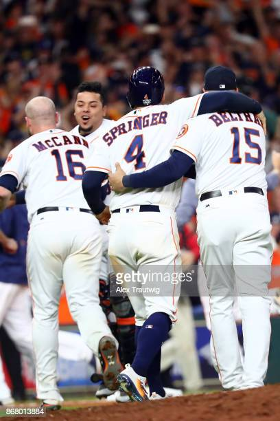 Brian McCann George Springer Juan Centeno and Carlos Beltran of the Houston Astros celebrate after the Astros defeated the Los Angeles Dodgers in 10...