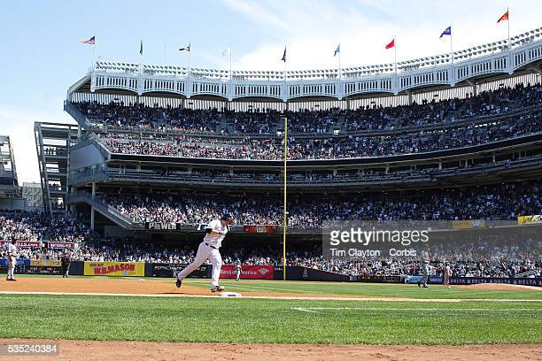 Brian McCann New York Yankees rounds third base after his solo home run in the fourth inning during the New York Yankees V Boston Red Sox baseball...