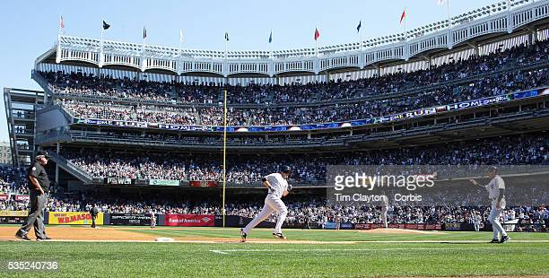 Brian McCann New York Yankees rounds third base after hitting his second home run of the day in the sixth inning during the New York Yankees V Boston...