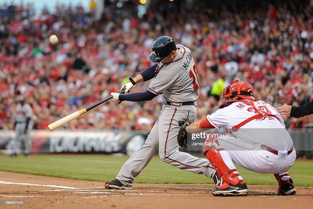 Brian McCann #16 of the Atlanta Braves bats against the Cincinnati Reds at Great American Ball Park on May 7, 2013 in Cincinnati, Ohio.