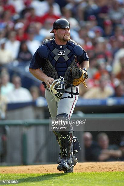 July 26: Brian McCann of the Atlanta Braves catches during the game against the Philadelphia Phillies at Citizens Bank Park in Philadelphia,...