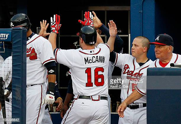 Brian McCann of the Atlanta Braves celebrates after a solo homer in the fourth inning against the Kansas City Royals at Turner Field on June 19 2010...