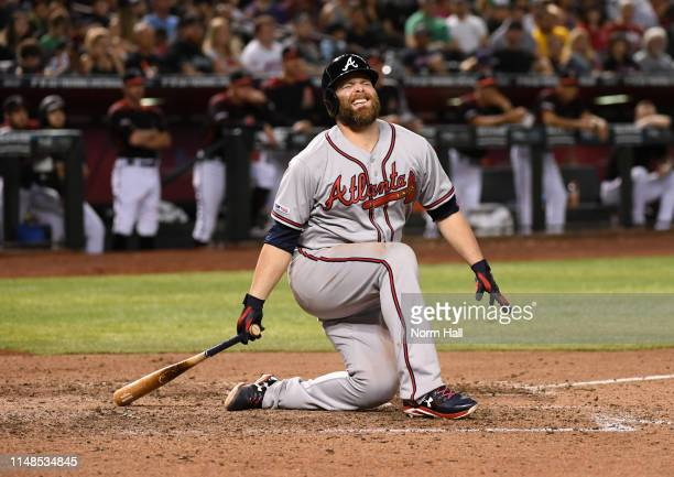Brian McCann of the Atlanta Braves grimaces after fouling a ball off of his foot against the Arizona Diamondbacks during the eighth inning at Chase...
