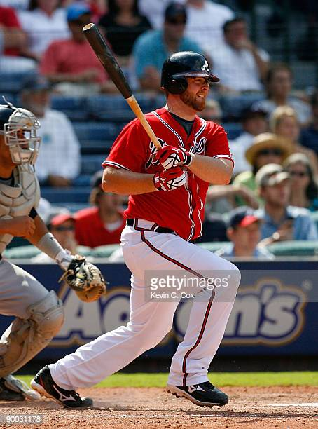 Brian McCann of the Atlanta Braves hits a two-run single in the bottom of the eighth inning against the Florida Marlins on August 23, 2009 at Turner...