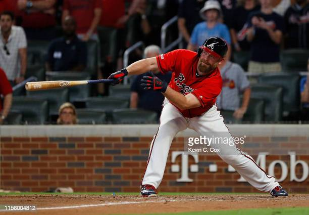 Brian McCann of the Atlanta Braves hits a walk-off single to score two runs to give the Braves a 9-8 win over the Philadelphia Phillies at SunTrust...