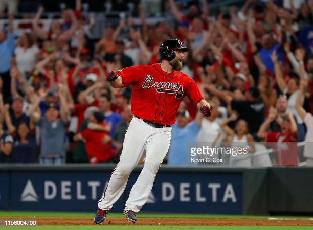 Brian McCann of the Atlanta Braves reacts after hitting a walk-off single to score two runs to give the Braves a 9-8 win over the Philadelphia...