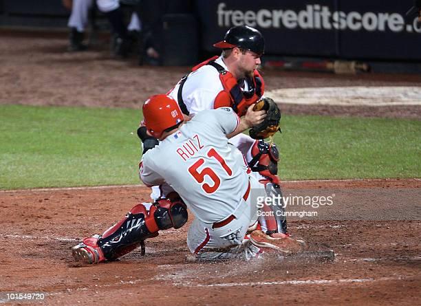 Brian McCann of the Atlanta Braves tags out Carlos Ruiz of the Philadelphia Phillies at Turner Field on June 1, 2010 in Atlanta, Georgia. The Braves...