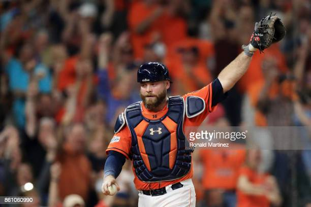 Brian McCann of the Houston Astros celebrates after tagging out Greg Bird of the New York Yankees at home in the fifth inning during game one of the...
