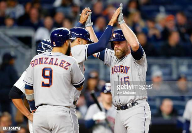 Brian McCann of the Houston Astros celebrates his three run home run against the New York Yankees with teammates Carlos Correa and Marwin Gonzalez at...