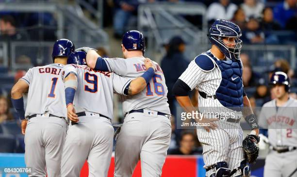Brian McCann of the Houston Astros celebrates his three run home run with teammates Carlos Correa and Marwin Gonzalez as Gary Sanchez of the New York...
