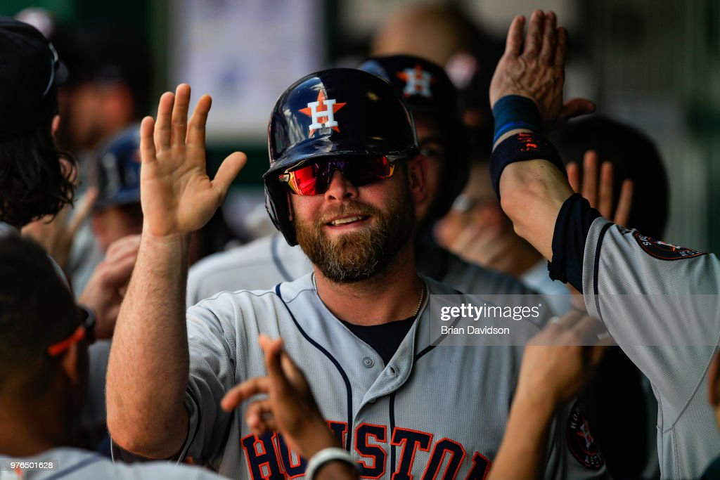 Brian McCann #16 of the Houston Astros celebrates scoring during a three run home run hit by Alex Bregman #2 against the Kansas City Royals during the ninth inning at Kauffman Stadium on June 16, 2018 in Kansas City, Missouri.