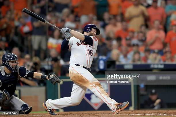 Brian McCann of the Houston Astros hits a double to right field to score Carlos Correa and Yuli Gurriel against Tommy Kahnle of the New York Yankees...