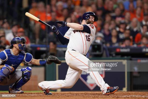 Brian McCann of the Houston Astros hits a solo home run during the eighth inning against the Los Angeles Dodgers in game five of the 2017 World...