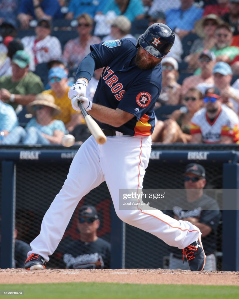 Brian McCann #16 of the Houston Astros hits the ball against the Atlanta Braves during a spring training game at The Ballpark of the Palm Beaches on February 24, 2018 in West Palm Beach, Florida.