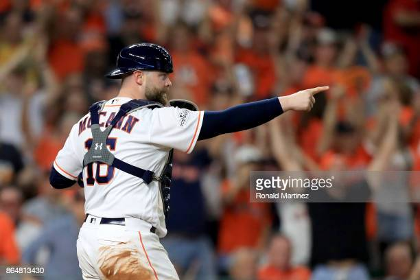 Brian McCann of the Houston Astros reacts after tagging out Greg Bird of the New York Yankees at home plate during the fifth inning in Game Seven of...
