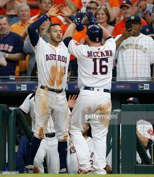 Brian McCann of the Houston Astros receives congratulations from Carlos Correa after a sixth inning home run Los Angeles Angels of Anaheim at Minute...