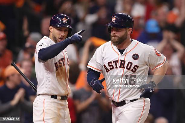 Brian McCann of the Houston Astros rounds the bases after hitting a solo home run during the eighth inning against the Los Angeles Dodgers in game...