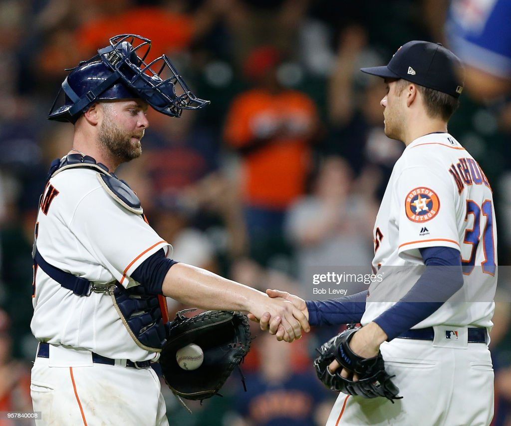 Brian McCann #16 of the Houston Astros shakes hands with Collin McHugh #31 after the final out against the Texas Rangers at Minute Maid Park on May 12, 2018 in Houston, Texas.