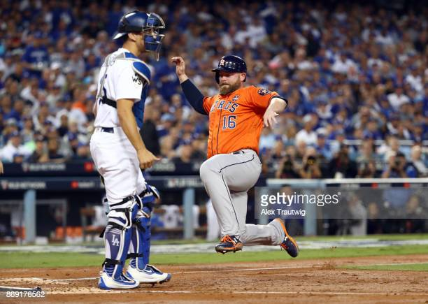 Brian McCann of the Houston Astros slides home to score on Lance McCullers Jr's RBI ground out in the second inning of Game 7 of the 2017 World...