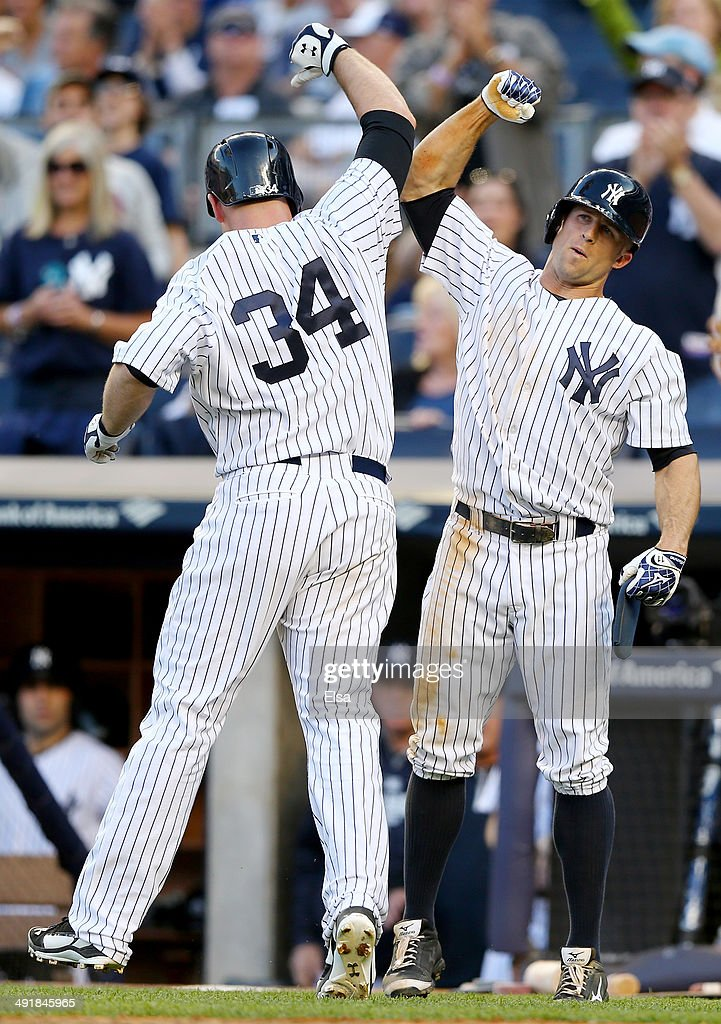 Brian McCann #34 of the New York Yankees celebrates his two run homer with teammate Brett Gardner #11 in the eighth inning against the Pittsburgh Pirates on May 17, 2014 at Yankee Stadium in the Bronx borough of New York City.The New York Yankees defeated the Pittsburgh Pirates 7-1.