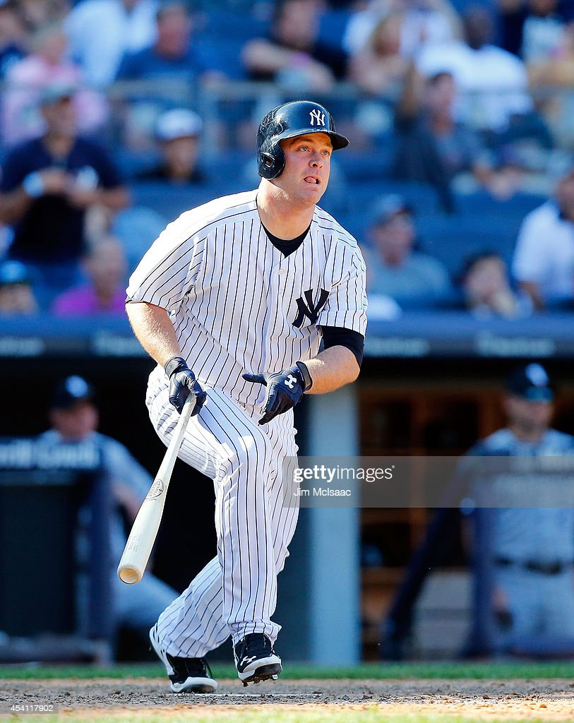 Brian McCann #34 of the New York Yankees follows through on his tenth inning game winning three run home run against the Chicago White Sox at Yankee Stadium on August 24, 2014 in the Bronx borough of New York City. The Yankees defeated the White Sox 7-4 in ten innings.