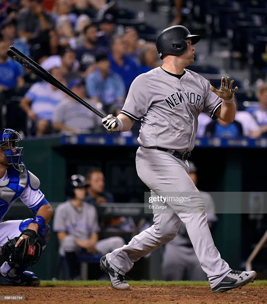 Brian McCann #34 of the New York Yankees hits a sacrifice fly in the 13th inning against the Kansas City Royals at Kauffman Stadium on August 31, 2016 in Kansas City, Missouri.