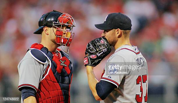 Brian McCann talks to Brandon Beachy of the Atlanta Braves during a timeout against the Philadelphia Phillies at Citizens Bank Park on September 7...