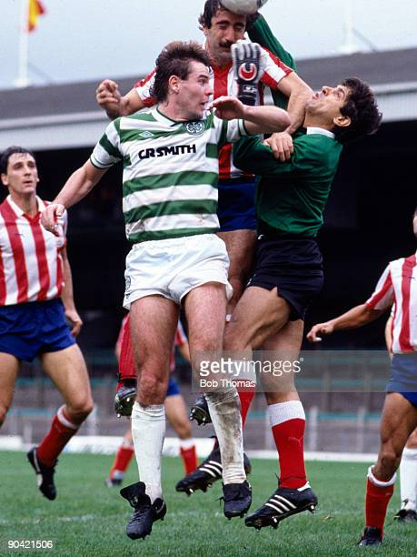 Brian McClair of Celtic clashes with Juan Arteche and goalkeeper Ubaldo Fillol of Athletico Madrid during the Celtic v Athletico Madrid European Cup...