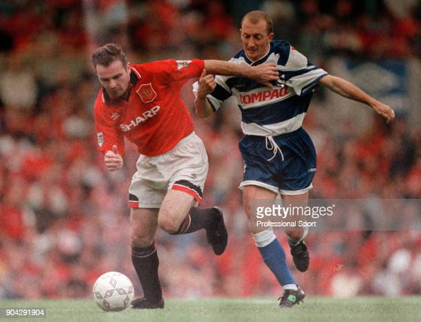 Brian McClair of Manchester United and Ian Holloway of Queens Park Rangers in action during the FA Carling Premiership match at Old Trafford on...