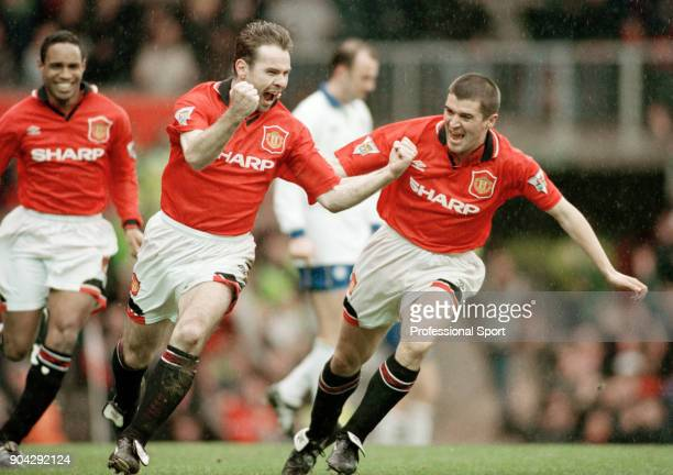 Brian McClair of Manchester United celebrates with teammates Roy Keane and Paul Ince after scoring during the FA Cup 5th Round match between...