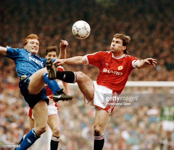 Brian McClair of Manchester United competes with Stuart McCall of Everton during the Barclays League Division One match between Manchester United and...