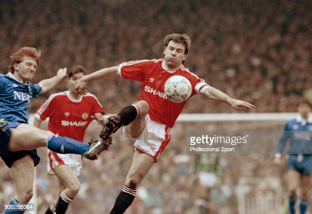 Brian McClair of Manchester United is challenged by Stuart McCall of Everton during a Barclays League Division One match at Old Trafford on March 2...