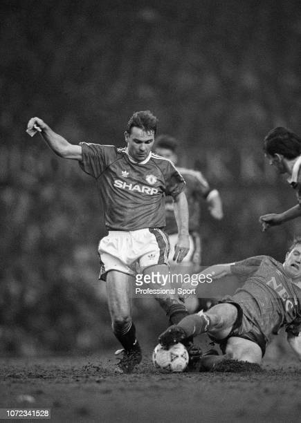 Brian McClair of Manchester United is tackled by Stuart McCall of Everton during a Barclays League Division One match at Old Trafford on March 2 1991...