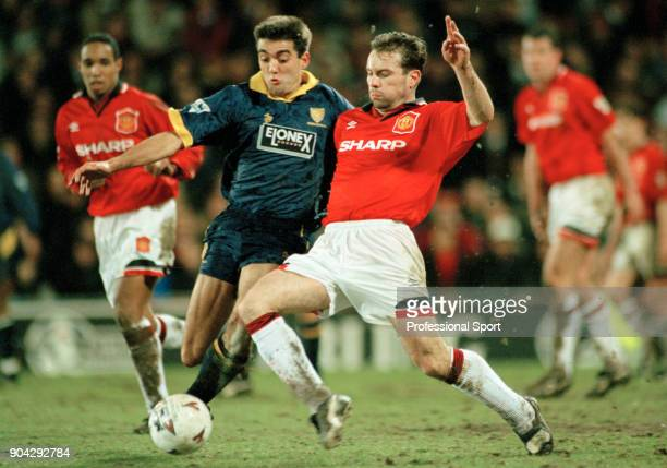 Brian McClair of Manchester United tackles Jon Goodman of Wimbledon during an FA Carling Premiership match at Selhurst Park on March 07 1995 in...
