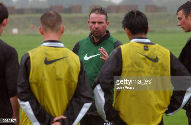 Brian McClair talks to the Manchester United Under19 squad during a training session at the Carrington training ground on August 9 2002