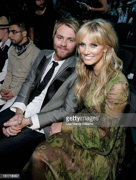 Brian McFadden and Delta Goodrem are seen in the audience glamour pit at the Vodafone MTV Australia Awards 2009 at the Sydney Convention and...