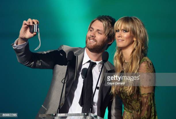 Brian McFadden and Delta Goodrem present on stage at the Vodafone MTV Australia Awards 2009 at the Sydney Convention and Exhibition Centre Darling...