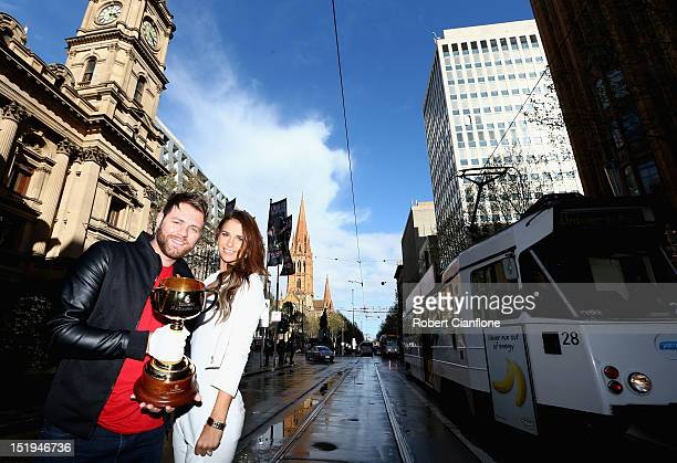 Brian McFadden and Vogue Williams pose with the 2012 Emirates Melbourne Cup at the Emirates Melbourne Cup Carnival media launch at Melbourne Town...
