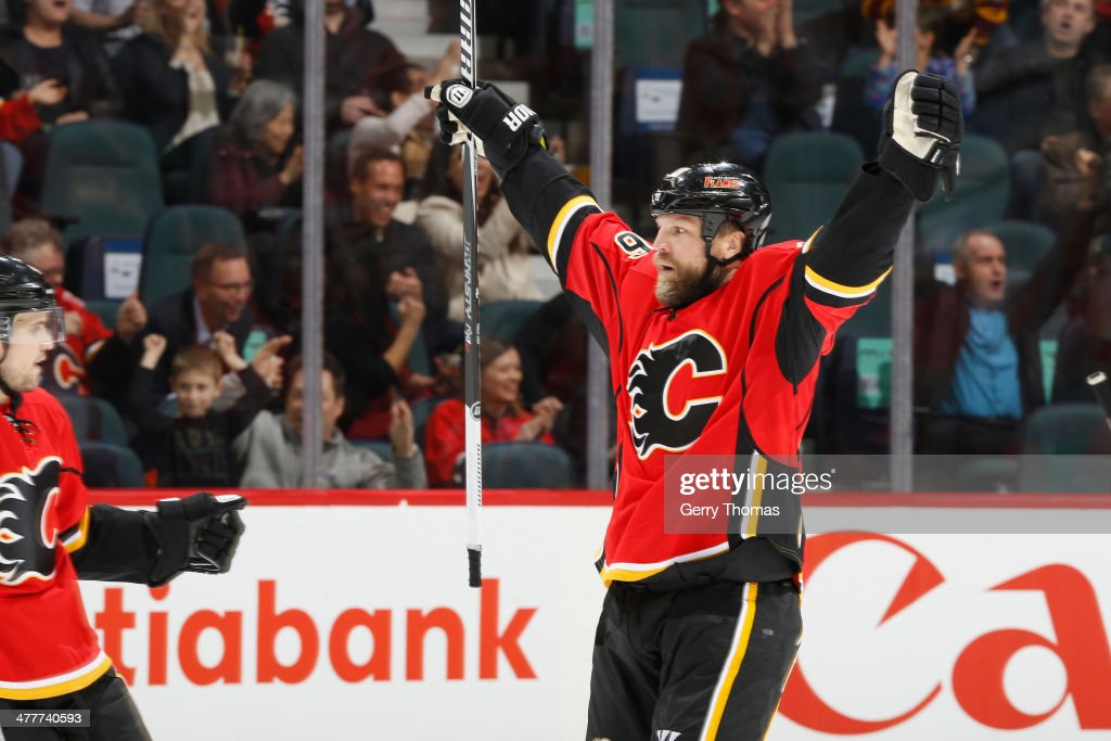 Brian McGrattan #16 of the Calgary Flames celebrates a goal against the Los Angeles Kings at Scotiabank Saddledome on March 10, 2014 in Calgary, Alberta, Canada.