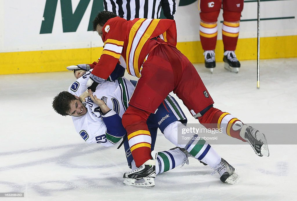 Brian McGrattan #16 of the Calgary Flames fights Tom Sestito #29 of the Vancouver Canucks during their NHL game at the Scotiabank Saddledome on March 3, 2013 in Calgary, Alberta, Canada.