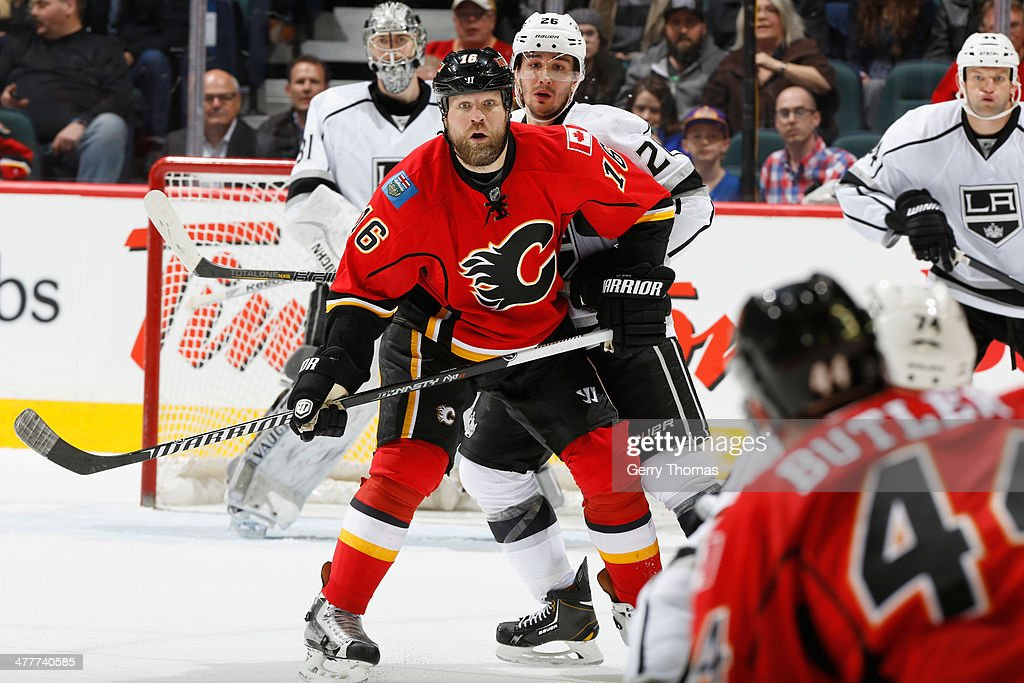 Brian McGrattan #16 of the Calgary Flames sets up in front of the net against Slava Voynov #26 of the Los Angeles Kings at Scotiabank Saddledome on March 10, 2014 in Calgary, Alberta, Canada.