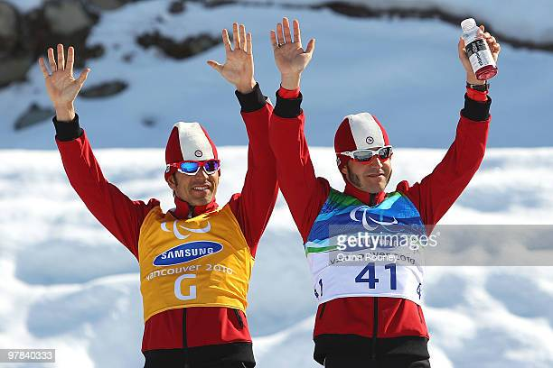 Brian McKeever and guide Robin McKeever of Canada celebrate winning the Men's 10km Visually Impaired Cross-Country Skiing during Day 7 of the 2010...