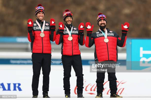 Brian McKeever and his guide Graham Nishikawa and Collin Cameron of team Canada celebrate after winning the Bronze medal for the 4x25km open relay...
