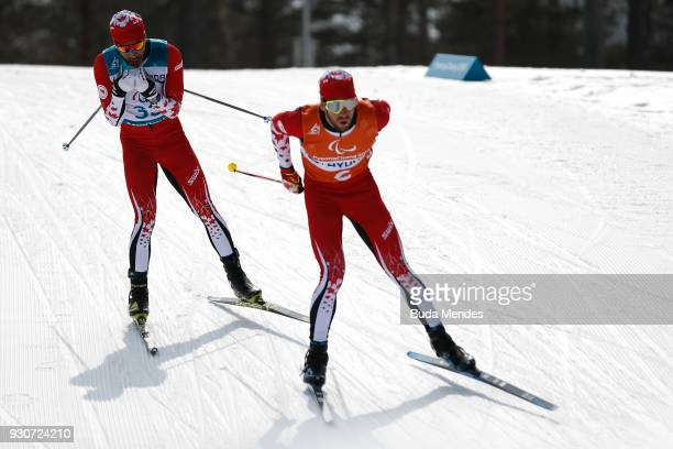 Brian McKeever and his guide Graham Nishikawa of Canada compete in the Men's Cross Country 20km Free Visually Impaired event at Alpensia Biathlon...