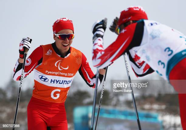 Brian McKeever and his guide Graham Nishikawa of Canada react after winning the Gold Medal for the Men's 20km free Visually Impaired crosscountry...