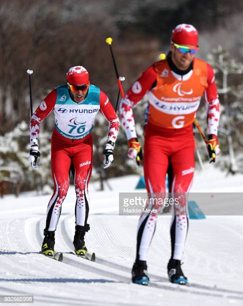 Brian McKeever of Canada and his guide Graham Nishikawa compete in the Men's 10 km Visually Impaired Classic at Alpensia Biathlon Centre on Day 8 of...