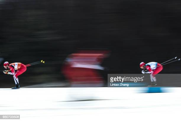 Brian McKeever of Canada and his guide Graham Nishikawa competes in the Men's 20km Free Visually Impaired Cross Country event at Alpensia Biathlon...