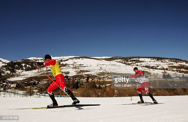 Brian McKeever of Canada is led by his guide Robin McKeever while competing in the Men's 75 KM Visually Impaired Biathlon during Day Four of the...