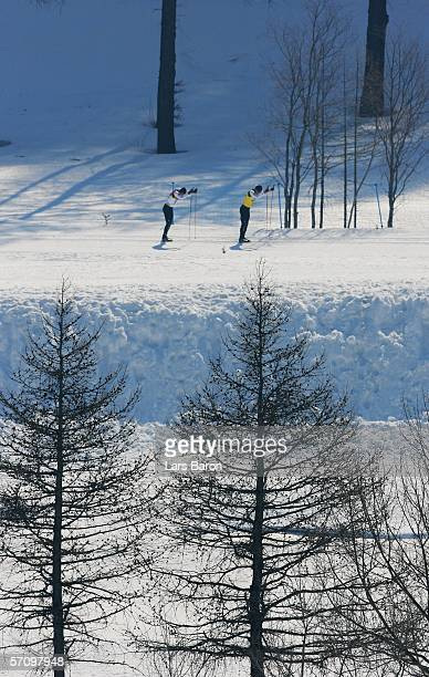 Brian McKeever of Canda is led by his guide Robin McKeever while on the way to winning the Gold Medal in the Men's 10 KM - Visually Impaired Cross...